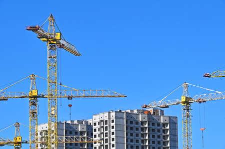 Crane and building under construction against blue sky Stock fotó