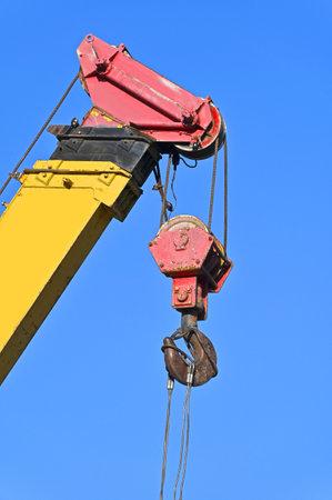 Mobile construction tower crane against blue sky
