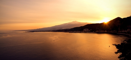 Landscape from Taormina: you can see the mount Etna beyond the Giardini Naxos Bay photo