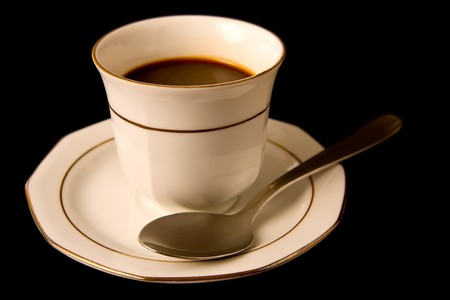Coffee cup with saucer and spoon isolated on black background Stock Photo - 6992499