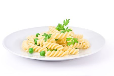 fusilli: A plate of Italian fusilli pasta with peas and parsley isolated on white background