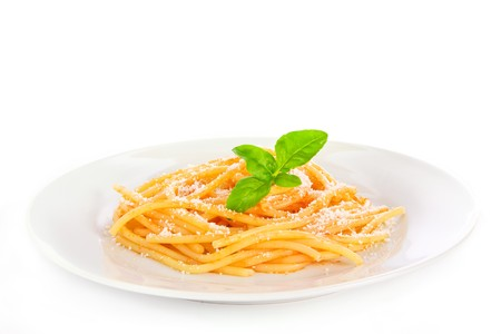 A plate of spaghetti pasta with tomato sauce and a basil leaf; isolated on white background photo