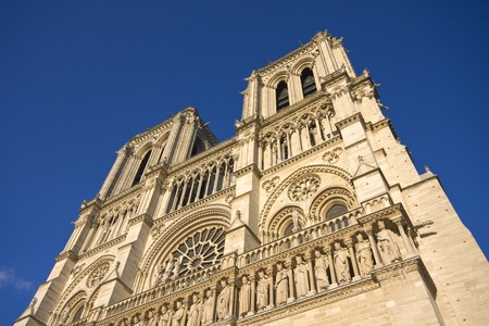 Facade of Notre Dame in Paris on blue sky photo