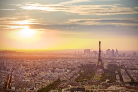 fense: Paris skyline at sunset with Eiffel tower on the right Stock Photo