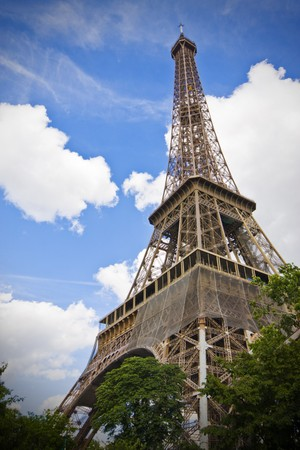 Paris - Eiffel Tower on a blue sky with clouds; copy space on left photo