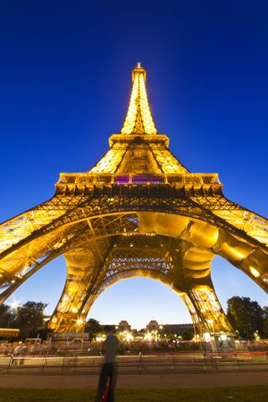 PARIS - July 20 : Eiffel tower at night on July 20, 2010 in Paris. The Eiffel tower is the most visited monument of France. Stock Photo - 7659711