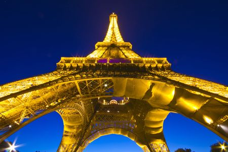 PARIS - July 20 : Eiffel tower at night on July 20, 2010 in Paris. The Eiffel tower is the most visited monument of France. Stock Photo - 7659709
