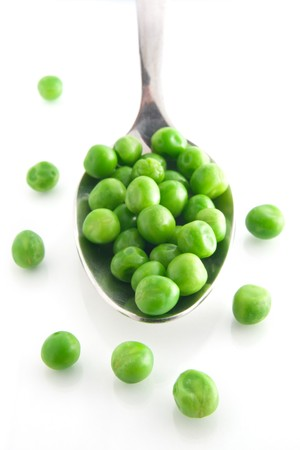 sweet pea: Fresh Green Peas on a silver spoon. White background