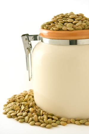 green lentil: Green lentil in a ceramic bowl, isolated on white background Stock Photo
