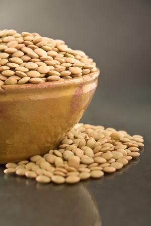 green lentil: Green lentil in a ceramic bowl, dark background Stock Photo