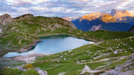 dolomites: Coldai lake in Dolomites, Italy; Marmolada Mount on background Stock Photo