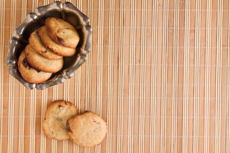 homemade chocolate chip cookie on a bamboo cane  matting photo