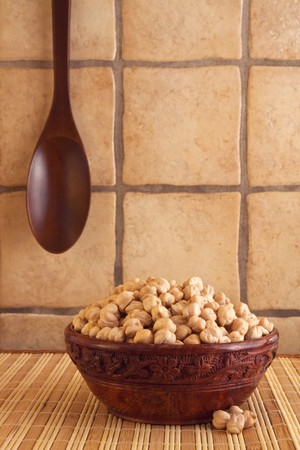 Chickpeas in a wooden bowl. photo