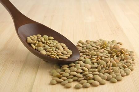 green lentil: Green lentil on a wooden spoon