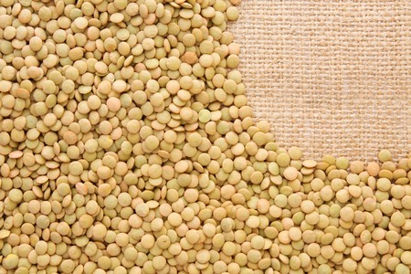 green lentil: Green lentil  background on burlap - with copy space