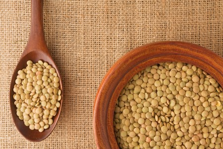 green lentil: Green Lentil in a wooden bowl and on a spoon