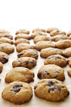 homemade chocolate chip cookie arranged on a table photo