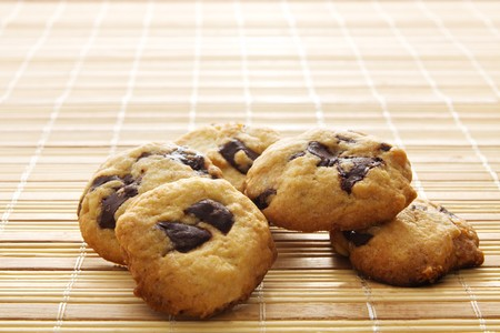 chocolate chip cookie on a bamboo mat photo