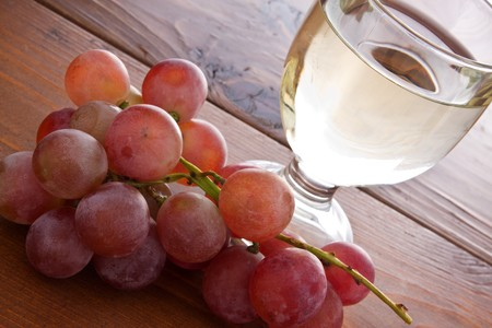 Red grape and white wine on a wooden table Stock Photo - 8245173