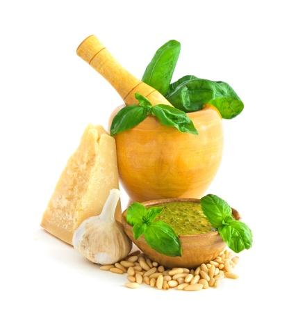Ingredients to make basil pesto sauce isolated on white background photo