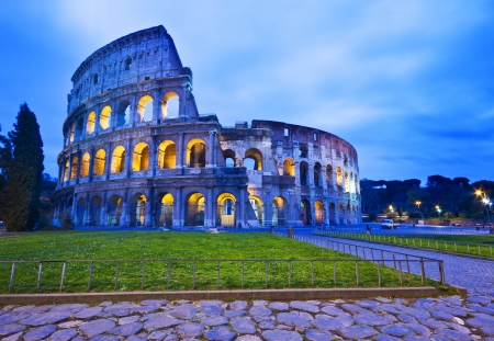 roman amphitheater: The Coliseum (or Colosseum) in Rome, Italy by night Stock Photo