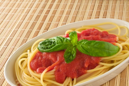 Spaghetti Pasta with tomato sauce  on bamboo mat photo