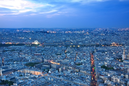 fense: Paris skyline by night with Louvre museum and Sacre coeur Stock Photo