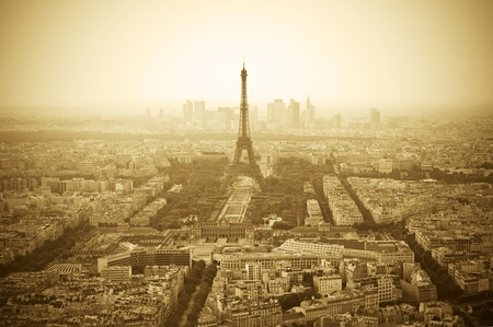 Parisian skyline with Eiffel Tower (Tour Eiffel) - Sepia toned image photo