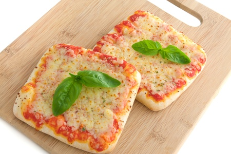Two pieces of Pizza on a cutting board photo
