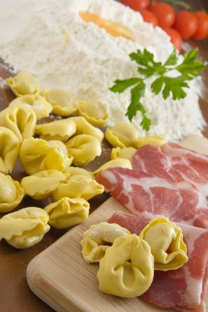 Preparing homemade tortellini pasta photo