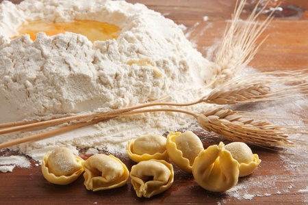 Tortellini pasta with wheat and flour photo