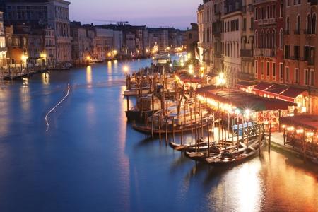 Venice, Italy - Gondolas parked in Grand Canal, near Rialto bridge photo
