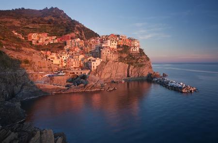 The beautiful Manarola fishing village by the sea, Liguria, Italy  photo