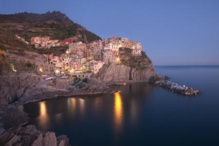 liguria: The beautiful Manarola fishing village in Liguria, Italy at dusk