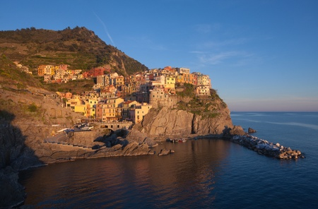 The beautiful Manarola fishing village in Italy in a summer day  photo