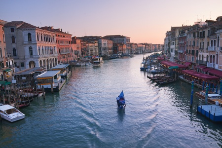 Venice, Italy - Gondola in Grand Canal at sunset photo