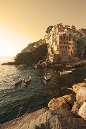 boats on the sea in riomaggiore, liguria, italy
