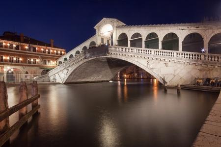Rialto Bridge (Ponte di Rialto) in Venice, Italy at dusk photo