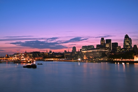 thames: Skyline of the City of London at dusk. Thames River on foreground, copy space in the sky