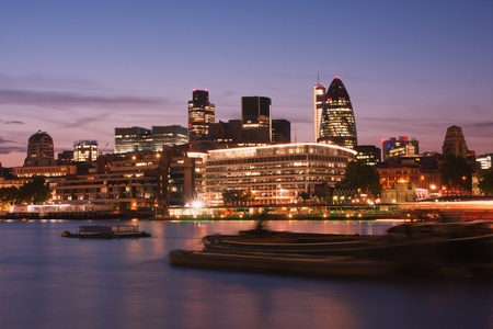 city of london: Skyline of the City of London at dusk - Thames river on foreground