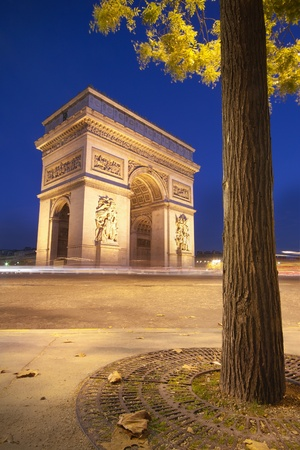 Arc de Triomphe (arch of triumph) in Paris at dusk photo