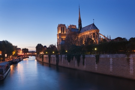 Rear view of Notre Dame cathedral in Paris, France, at dusk