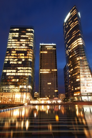 Office buildings illuminated at night - image taken in the financial district La Defense, Paris.