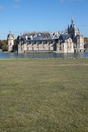 chantilly: Chantilly Castle in France -green grass on foreground