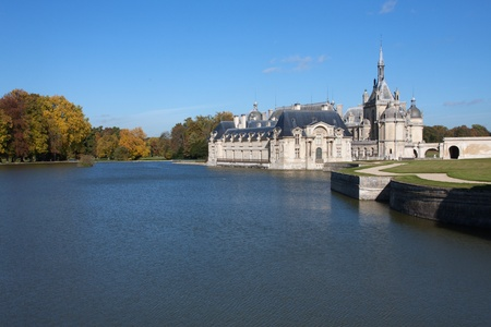 chantilly: Chantilly Castle in France - lake on foreground
