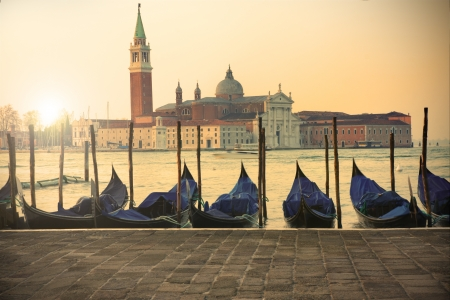 San Giorgio Maggiore island in Venice at sunset - gondolas on foreground photo