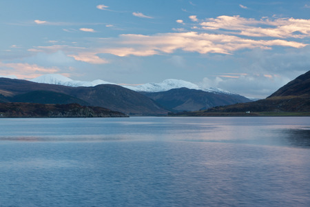 snowcapped: Snowcapped mountains by the sea at Ullapool, Scotland