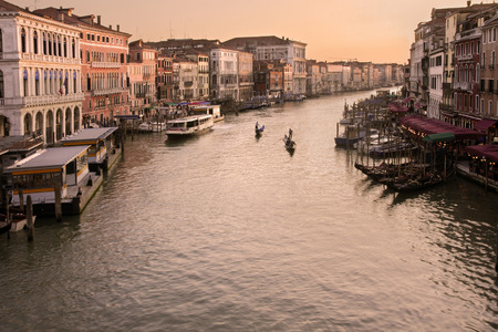 Grand Canal in Venice, Italy at sunset with gondolas photo