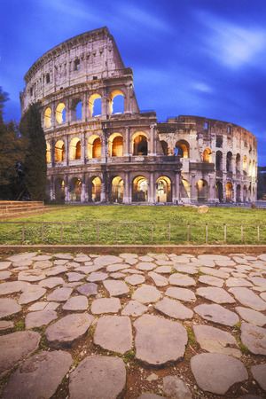 Rome, Italy: front view of Coliseum at dusk photo