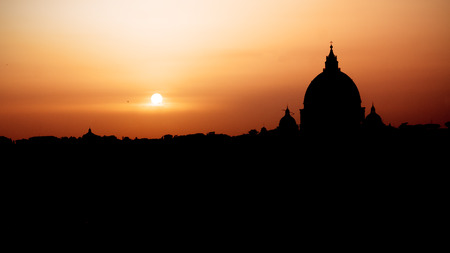 peters: Beautiful sunset in rome; silhouetted St. Peters Basilica